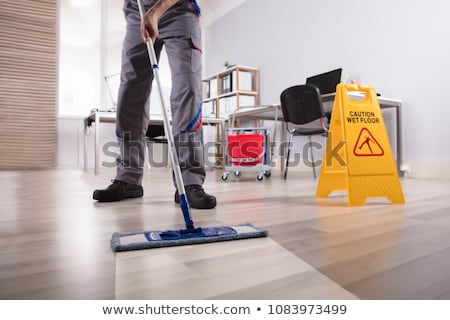 Male Janitor Cleaning Floor With Mop Stock photo © AndreyPopov