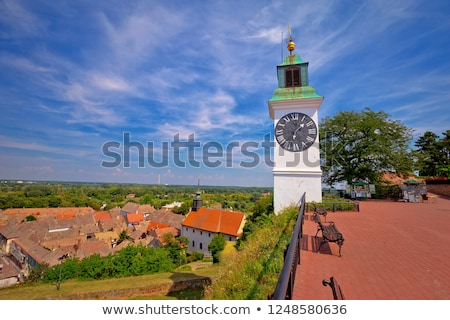 Petrovaradin clock tower and rooftops on Danube coast view Stock photo © xbrchx