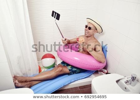Człowiek okulary nadmuchiwane basen materac wypoczynku Zdjęcia stock © dolgachov