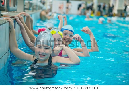 cute white boy in swimming class stock photo © zkruger