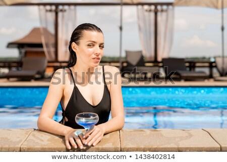 молодые · женщину · черный · шезлонг - Сток-фото © pressmaster