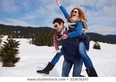 Stock photo: Romantic Couple Having Fun In Snow
