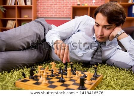 Fiatal jóképű főnök játszik sakk törik Stock fotó © Elnur