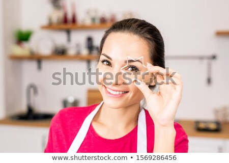 Young smiling woman holding star shaped cutter for homemade cookies by face Stock photo © pressmaster
