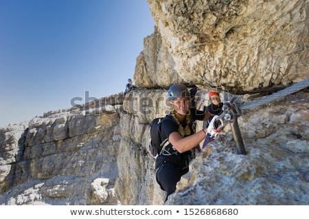 Férfi csinos női mászik kő nő Stock fotó © lightpoet