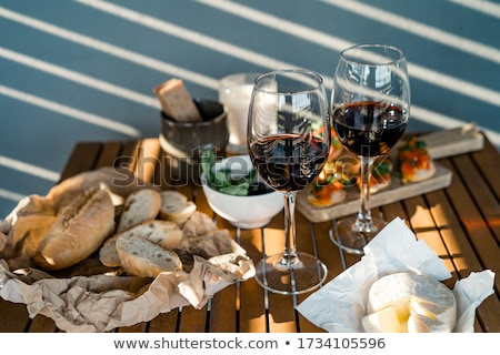 Stock photo: Bruschetta appetizer with red wine on wooden table