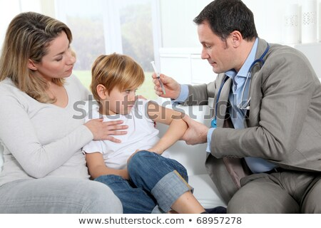 Doctor Immunising a Child Stock photo © lovleah