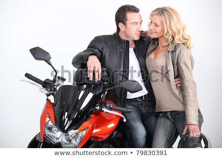 Biker couple gazing into each other's eyes. Stock photo © photography33