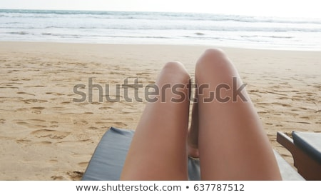 young woman lying on a beach lounger Stock photo © GekaSkr