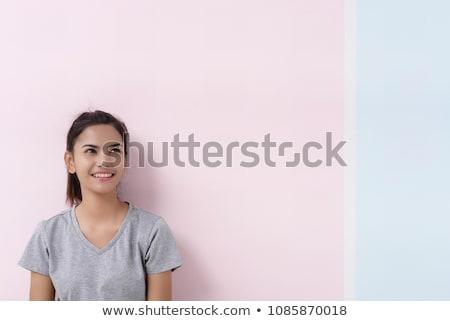 Zdziwiony młoda kobieta patrząc niebieski shirt Zdjęcia stock © pablocalvog