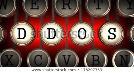 DDOS on Old Typewriter's Keys. Stock photo © tashatuvango