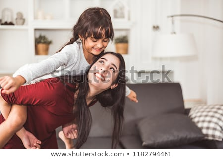 happy mother and child doing piggy back Stock photo © dolgachov