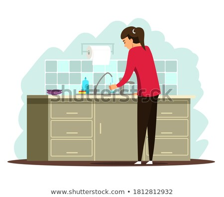 Thirsty young woman pouring a glass of water Stock photo © dash