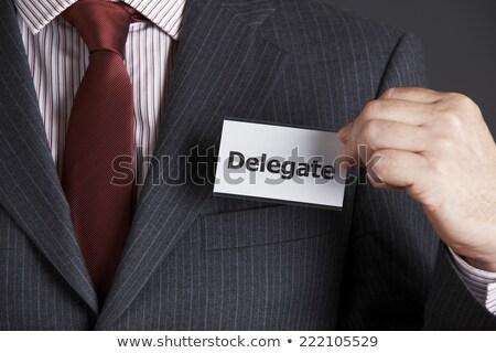 Businessman Attaching Delegate Badge To Jacket Stock photo © HighwayStarz
