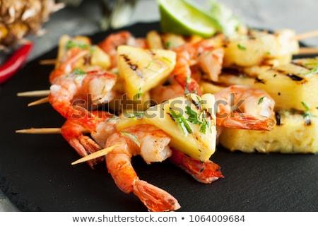 Skewer shrimp with pineapple Stock photo © joannawnuk