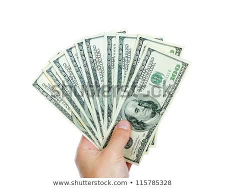 closeup portrait of a male hand giving dollars stock photo © deandrobot