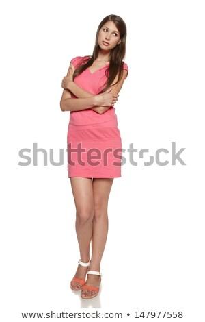 full length portrait of a pensive sporty woman stock photo © deandrobot
