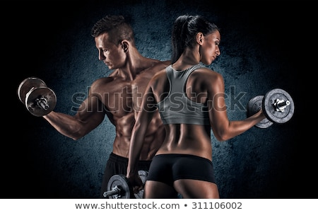 Muscular man with woman at gym Stock photo © deandrobot