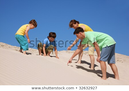 Family plays on the beach, found something Stock photo © Paha_L