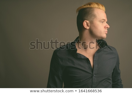 Businessman with mohawk. Stock photo © iofoto