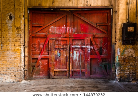 Old industrial warehouse locked gate Stock photo © stevanovicigor