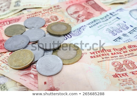 Different banknotes and coins  of Indian money Stock photo © CaptureLight