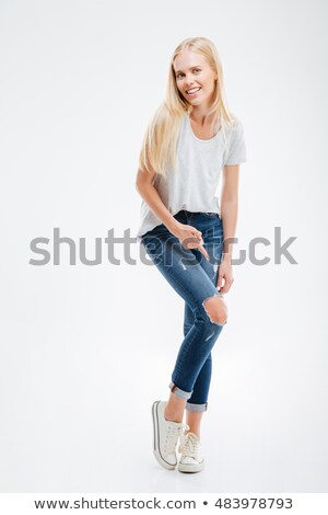 Smiling young woman showing ripped pants Stock photo © deandrobot