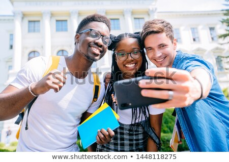 Ethnic male student smiling stock photo © lovleah