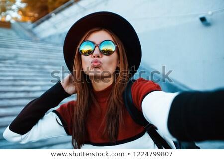 Güzel bir kadın hava öpücük ayakta açık havada Stok fotoğraf © deandrobot