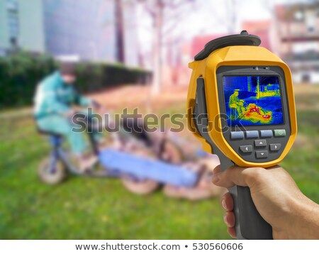 Recording with Thermal camera workers cutting grass in city park Stock photo © smuki