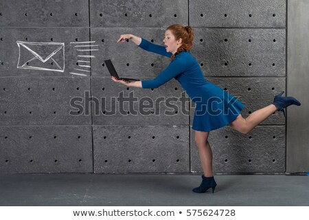 Businesswoman pushing fast forward button Stock photo © stevanovicigor
