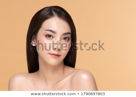 Attractive asian model with bright makeup look at camera Stock photo © deandrobot