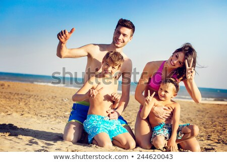 happy smiling young boy  at the beach gives thumbs up sign Stock photo © meinzahn