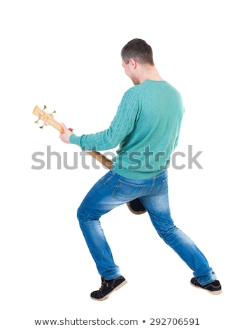 rear view of man playing guitar stock photo © wavebreak_media