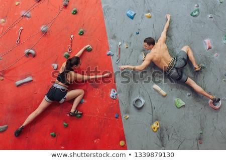 Full length of female athlete rock climbing in club Stock photo © wavebreak_media