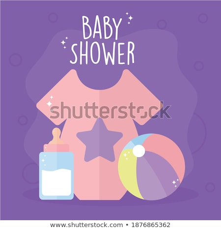 cute baby boy in colorful shirt with milk stock photo © Traimak