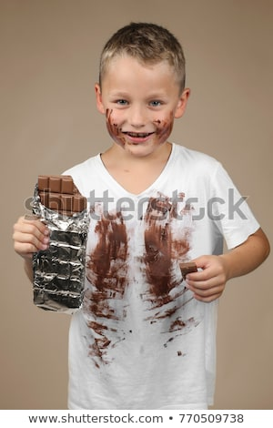 cute happy little boy in colorful shirt with milk stock photo © Traimak
