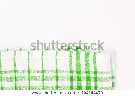 Red cloth, a kitchen towel with a checkered pattern, on a white  Stock photo © TanaCh