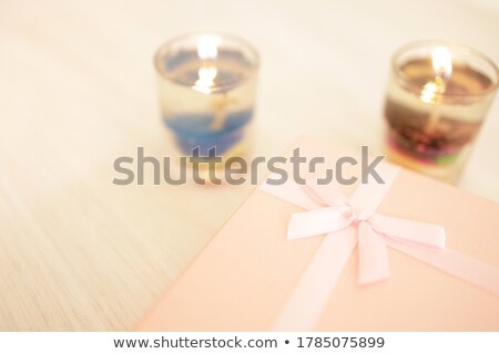 Wrapped Gift Glossy Wrapping Pink Paper with Bow Stock photo © robuart