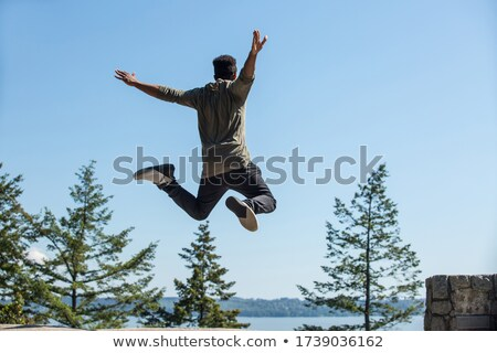Athletic man jumping in forest Stock photo © FreeProd
