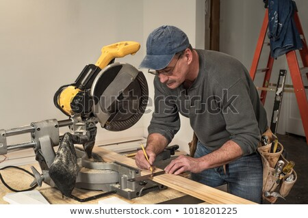 Carpenter cutting board with table saw Stock photo © Kzenon