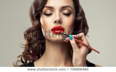 Bela mulher compensar escove batom beleza cosméticos Foto stock © dolgachov