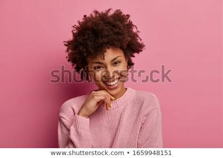 Photo of amusing african american woman smiling and touching her Stock photo © deandrobot