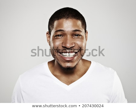 close up portrait of a happy young african man stock photo © deandrobot