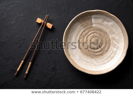 üres · tányér · evőpálcikák · fekete · mintázott · asztal - stock fotó © karandaev
