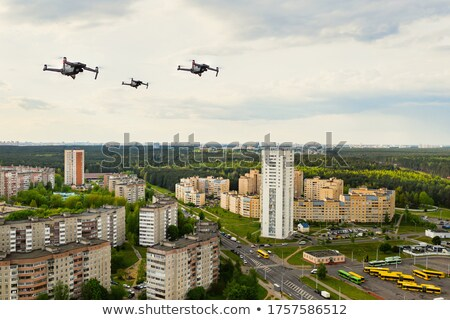 Quadrocopter drone with camera on sky together with airplane Stock photo © adamr