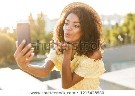 Fotó afroamerikai nő 20-as évek visel szalmakalap Stock fotó © deandrobot