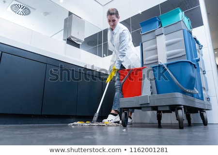 Cleaning lady or janitor mopping the floor in restroom Stock fotó © Kzenon