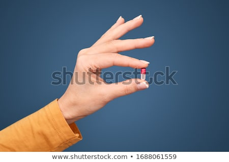 woman hand holding pills tablet stock photo © manaemedia
