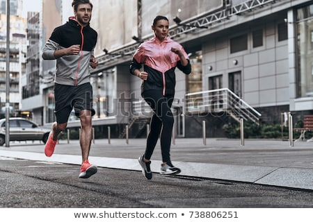 Paar sport kleding lopen buitenshuis fitness Stockfoto © dolgachov
